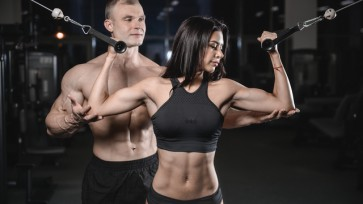 sexy caucasian man and woman in gym