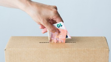 man putting euro money into donation box