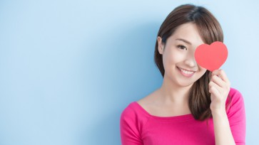 woman holding red love hearts