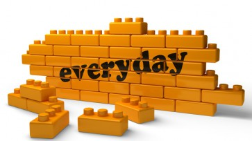 everyday word on yellow brick wall