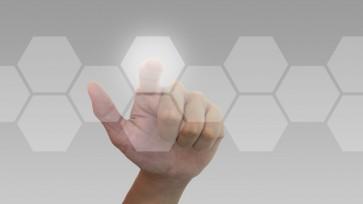 Hand pushing hexagonal button