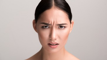 Irritated girl is expressing her negative emotions