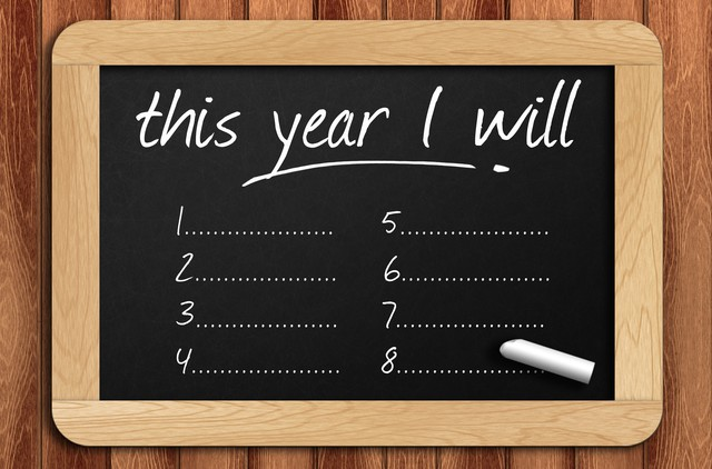 Chalkboard on the wooden table written this year I will