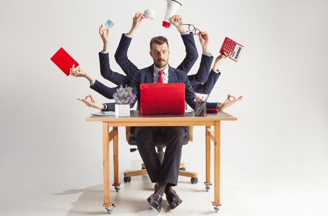 businessman with many hands in elegant suit working with paper, document, contract, folder, business plan.